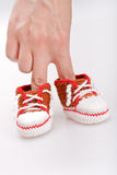 Crocheted booties for a boy Royalty Free Stock Photography