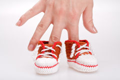 Crocheted booties for a boy Stock Image