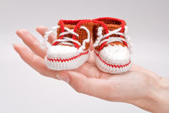 Crocheted booties for a boy Royalty Free Stock Photos