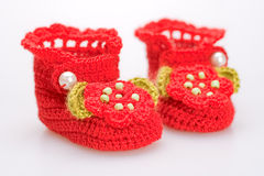 Crocheted booties for a girl Royalty Free Stock Image