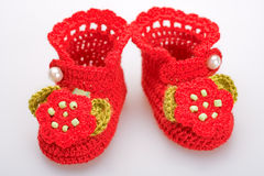 Crocheted booties for a girl Stock Photography