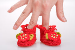 Crocheted booties for a girl Royalty Free Stock Photos