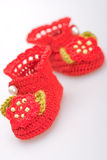 Crocheted booties for a girl Stock Photos
