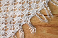Crocheted clothing on wooden surface Stock Photography