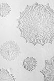 Crocheted doilies in gesso on a wall. White crocheted doilies in gesso on a wall, details Stock Images