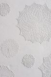Crocheted doilies in gesso on a wall Royalty Free Stock Images