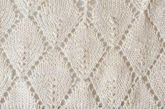 Crocheted doily close up. Glossy white crocheted doily, macro Stock Photos