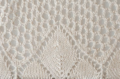 Crocheted doily close up. Glossy white crocheted doily, macro Stock Photography