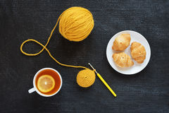 Crocheted element, lemon tea and biscuits Royalty Free Stock Images