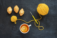 Crocheted element, lemon tea and biscuits Stock Images