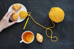 Crocheted element, lemon tea and biscuits Stock Photos