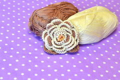 Crocheted flower, yarn on a lilac background Stock Photo