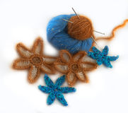 Crocheted flowers made of artificial and natural yarn Royalty Free Stock Photos