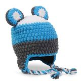 Crocheted hat on white royalty free stock images