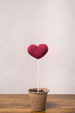 Crocheted heart in a peat glass Stock Photo