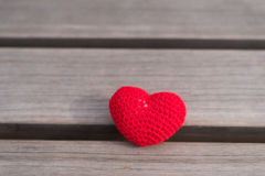 Crocheted heart on a wooden board Stock Photography