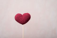Crocheted heart on a wooden stick Royalty Free Stock Image