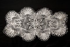 Crocheted lace napkin Stock Photos
