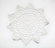 Crocheted lace on white Royalty Free Stock Photos