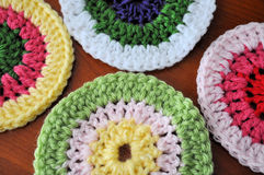 Crocheted Medallions. Crocheted round medallions on wood royalty free stock image