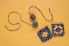 Crocheted motives on yellow background Royalty Free Stock Image