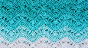 Crocheted multicolored cotton fabric In Turquoise colors. Stripe Royalty Free Stock Photography