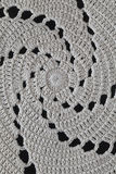 Crocheted spirals, black background, closeup Royalty Free Stock Photos