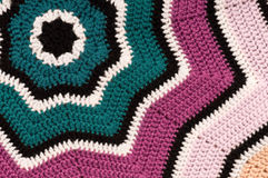 Crocheted star background. Crocheted, striped, star shaped blanket background. Detailed close-up of double crochet pattern royalty free stock photography