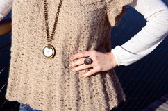 Crocheted sweater and clock necklace Royalty Free Stock Photography