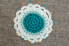 Crocheted Three-Tone Coaster Fastened with Pins on Muslin Cloth Royalty Free Stock Images