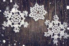 Crocheted white snow flakes Royalty Free Stock Image