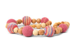 Crocheted and wooden pink beads isolated Royalty Free Stock Image