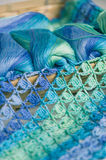 Crocheting in blue and green tones and skeins piled together Royalty Free Stock Photo