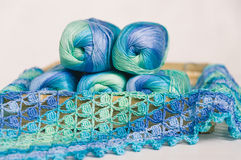 Crocheting in blue and green tones and skeins piled together Royalty Free Stock Image