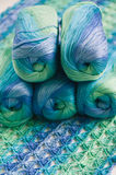 Crocheting in blue and green tones and skeins piled together Royalty Free Stock Photography