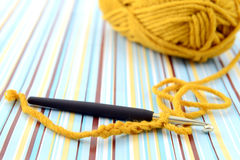 Crocheting with brown wool. retro paper Royalty Free Stock Photo
