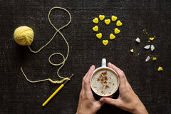 Crocheting, button heart and hands with coffee Royalty Free Stock Photo