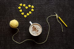 Crocheting, coffee and button heart Royalty Free Stock Images