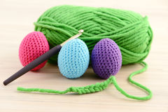 Crocheting easter eggs in green, pink, blue and purple Royalty Free Stock Photography