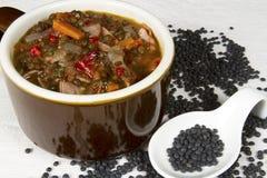 Crock of Beluga Lentil Soup Stock Image