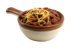 Crock of chili. A isolated crock of chili with cheese royalty free stock image
