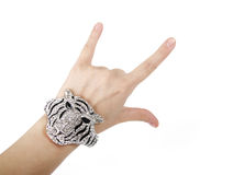Crock and roll hand sign and silver bracelet Stock Photos