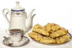 Crockery and the baking. Tea crockery and baking on white Royalty Free Stock Photos