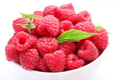 Crockery with beautiful ripe raspberries Royalty Free Stock Images