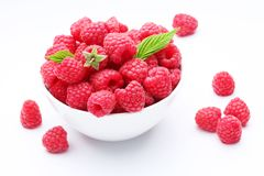 Crockery with  beautiful tempting raspberries. Stock Photos