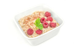 Crockery with beautiful tempting raspberries on white b stock photos