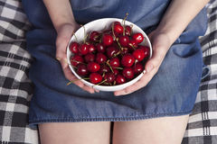 The Crockery with cherries in woman hands Royalty Free Stock Photos