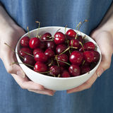 The Crockery with cherries in woman hands Stock Photos