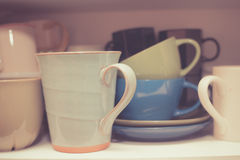 Crockery in cupboard Royalty Free Stock Photo