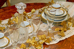 Crockery and glass. Luxury and expensive golden crockery and tableware stock photo